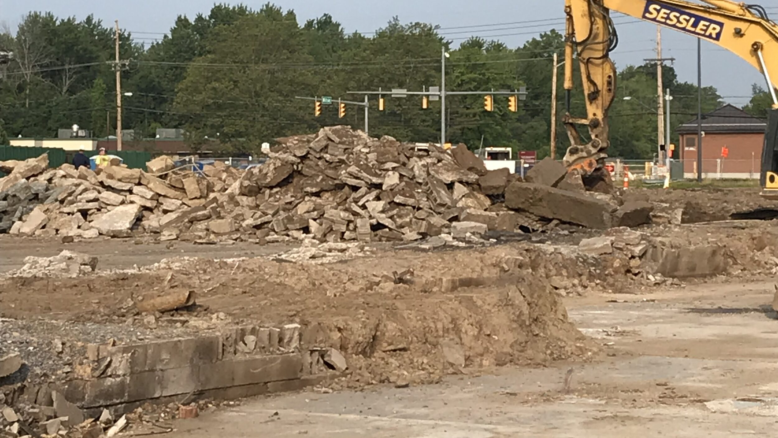 Excavator moving debris