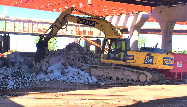 excavator removing concrete