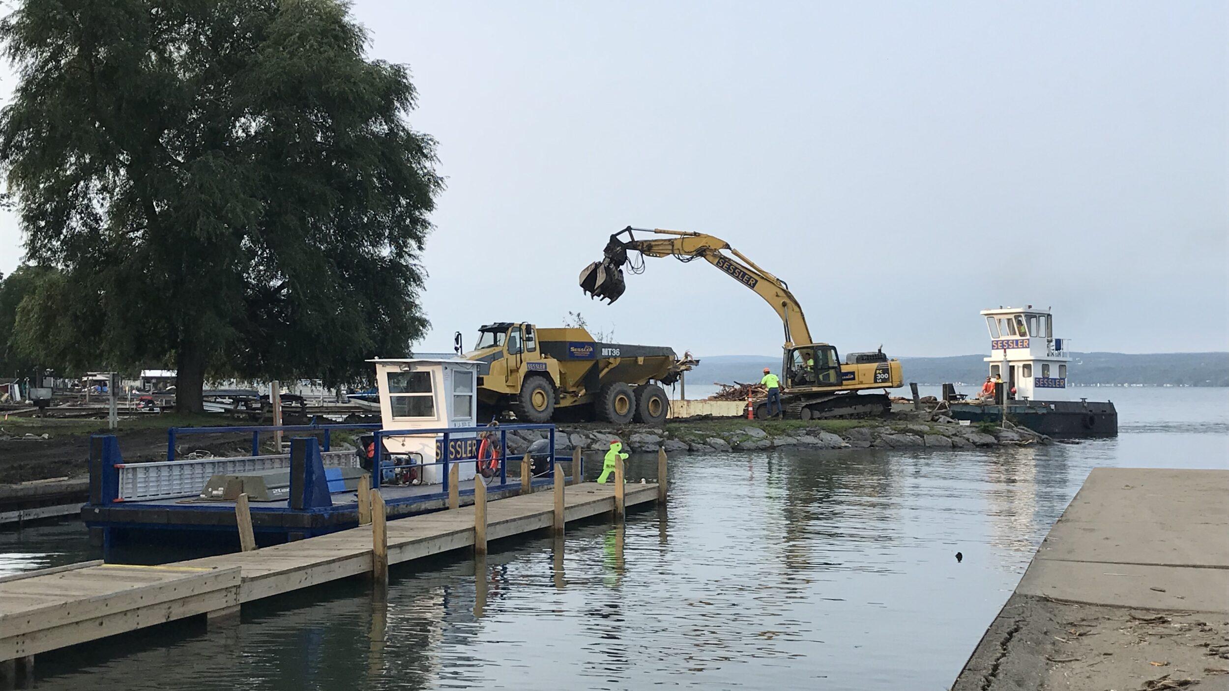 Excavator by lake